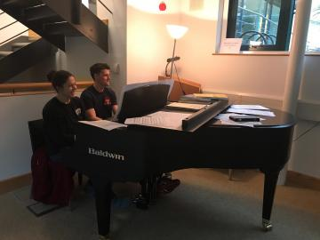 My office mates, Frazer and Rose, playing a duet on the Ertegun piano